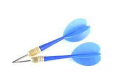 Dards bleus d'isolement. Photo stock