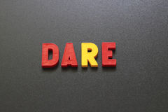 Dare. The image and the inscription letters on a blackboard Royalty Free Stock Image