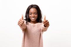 Dare motivato entusiasta della donna pollici su Fotografia Stock Libera da Diritti