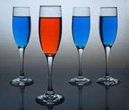 Dare to be Different. Wineglasses filled with colored liquid - illustrating concepts such as Workplace Diversity, Democrat versus Republican, or Dare to be Stock Photos