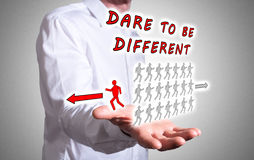 Dare to be different concept above a human hand Stock Photo