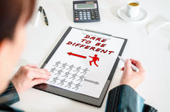 Dare to be different concept on a clipboard Royalty Free Stock Photography