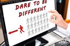 Dare to be different concept on a computer monitor Stock Photos