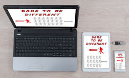 Dare to be different concept on different information technology devices Royalty Free Stock Images