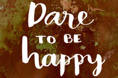 Dare to be happy hand lettering message Royalty Free Stock Images