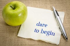 Dare to begin advice on napkin Royalty Free Stock Images