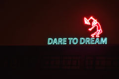 Dare to dream. Message communication on a building at night Royalty Free Stock Photography