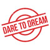Dare To Dream rubber stamp. Grunge design with dust scratches. Effects can be easily removed for a clean, crisp look. Color is easily changed Stock Photo