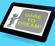 Dare To Dream Tablet Shows Wishes And Aspirations. Dare To Dream Tablet Showing Wishes And Aspirations Royalty Free Stock Images