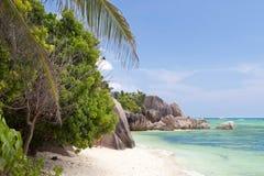 Dargent strandansekälla - Seychellerna Arkivfoto
