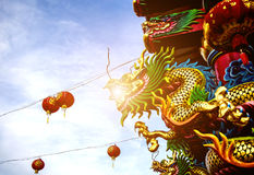Dargon statue on Shrine roof ,dragon statue on chin. A temple roof as asian art royalty free stock image