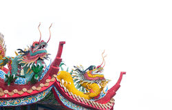 Dargon statue on Shrine roof on white background. Dragon statue on china temple roof as asian art royalty free stock photos