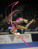 Daria Dmitrieva. Russian Rhythmic Gymnast Daria Dmitrieva goes through her ribbon routine at the 2012 Berlin Masters. The competition is one of the Rhythmic Stock Image