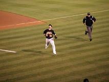 Daric Barton and Umpire run for ball Stock Photo
