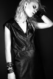 Daring girl model in black leather dress, style of Stock Photos