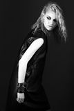 Daring girl model in black leather dress, style of Royalty Free Stock Image