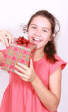 Daring girl opens gift Stock Images
