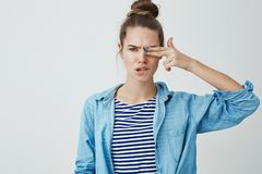Daring good-looking confident young 25s woman hair rolled hairbun, frowning grimacing cute biting lip sexy rebellious stock photos