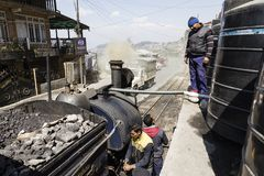 Darjeeling, India, March 3 2017: Filling the boiler of the steam locomotive. Called toy train Royalty Free Stock Image