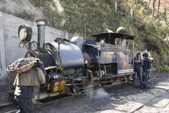 Darjeeling, India, March 3 2017: Heating the steam locomotive. And filling the coal bunker of the famous toy train Royalty Free Stock Photography