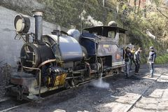 Darjeeling, India, March 3 2017: Heating the steam locomotive. And filling the coal bunker of the famous toy train Royalty Free Stock Image
