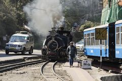 Darjeeling, India, March 3 2017: Heating the steam locomotive. And filling the coal bunker of the famous toy train Stock Images