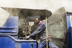 Darjeeling, India, March 3 2017: The locomotive driver drives the steam locomotive. Darjeeling, India, March 3 2017: The locomotive driver drives the famous Stock Photo