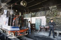 Darjeeling, India, March 3 2017: Prepare the steam locomotive for the drive. From Darjeeling to ghoom with the famous toy train Stock Photos