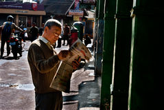 The Darjeeling Mall. A local man is reading newspaper in the morning at Darjeeling Chowrasta. The Chowrasta or the Mall is the heart of Darjeeling town. Located Stock Image