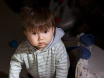 From the dark. Baby boy striving after light Stock Images