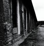 In the dark. Dark abandoned factory brick wall black and white Stock Photo