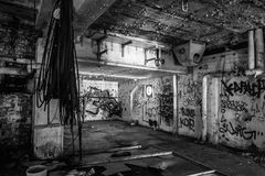 Dark abandoned scary factory room Stock Photo