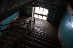 Dark abandoned stairway interior in old living house Royalty Free Stock Image