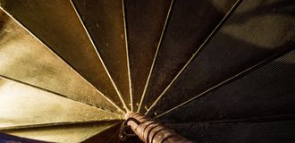 Dark abstract background helical Spiral staircase stairs royalty free stock image
