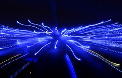 Dark abstract banner with perspective into the depths of the glo. Dark abstract banner with perspective into the depths of many bright neon blue lights Royalty Free Stock Image