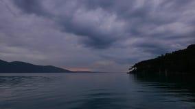 Dark Aegean Sunset in Autumn 06. A dark and overcast autumn sunset video showing Akyaka coastline Gulf of Gokova, Aegean Sea stock footage