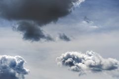 Dark air clouds and clouds in the blue sky stock photo