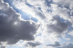 Dark air clouds in the blue sky royalty free stock photo