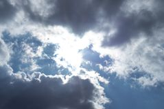 Dark air clouds in the blue sky stock photography