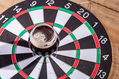 Dark ale and darts Stock Photography