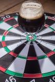 Dark ale and darts Royalty Free Stock Photos