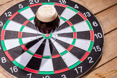 Dark ale and darts Stock Images