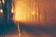 Dark alley in the fog Royalty Free Stock Image