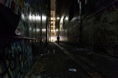 Dark alley with graffiti. Melbourne, Australia - April 22, 2015: Graffitis on the walls in an alleyway of Melbourne stock photo