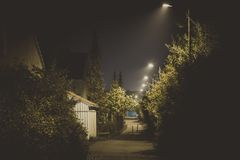 Dark alley at night royalty free stock photography