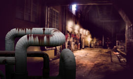 Dark alley. With rusty pipes in foreground Royalty Free Stock Image