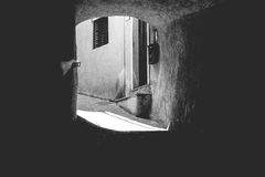 Dark alley or street in an old village or old city, Italy Royalty Free Stock Images