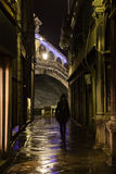 Dark alley in Venice with a silhouette of a woman. Dark alley in Venice with a view on the Rialto bridge and a silhouette of a woman stock images