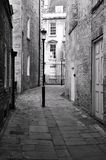 Dark Alleyway. View of a Dark Alleyway in Black and White Stock Photos
