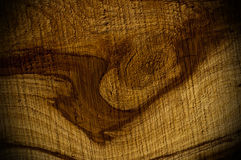 Dark almond wood texture with animal head shapes Stock Photo